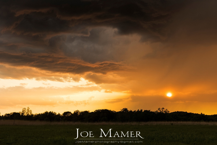 Clearing storm clouds at sunset on the Minnesota prairie.