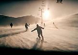 USA, California, people snowboarding at Mammoth mountain Ski Resort at dusk