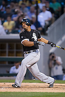 Jose Abreu (79) of the Chicago White Sox follows through on his swing against the Charlotte Knights at BB&T Ballpark on April 3, 2015 in Charlotte, North Carolina.  The Knights defeated the White Sox 10-2.  (Brian Westerholt/Four Seam Images)