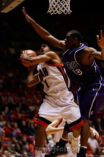 Salt Lake City - Utah's Johnnie Bryant is fouled on the shot by TCU's Alvardo Parker. University of Utah vs. TCU NCAA college basketball.  ; 1.06.2007<br />