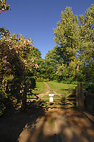 wooden gate leading to country trail in spring time, North Yorkshire, England. Sep 2007