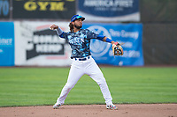 Ogden Raptors shortstop Ronny Brito (5) prepares to make a throw to first base during a Pioneer League game against the Billings Mustangs at Lindquist Field on August 17, 2018 in Ogden, Utah. The Billings Mustangs defeated the Ogden Raptors by a score of 6-3. (Zachary Lucy/Four Seam Images)