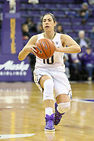 SEATTLE, WA - DECEMBER 18: Washington's #10 Kelsey Plum looks for an open teammate to pass the ball to against Savannah State.  Washington won 87-36 over Savannah State at Alaska Airlines Arena in Seattle, WA.