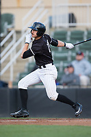 Jameson Fisher (11) of the Kannapolis Intimidators follows through on his swing against the Lakewood BlueClaws at Kannapolis Intimidators Stadium on April 6, 2017 in Kannapolis, North Carolina.  The BlueClaws defeated the Intimidators 7-5.  (Brian Westerholt/Four Seam Images)