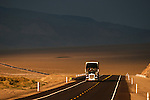 Trucks travel over US 95 in central Nevada..**Trucking company logos removed in post production.