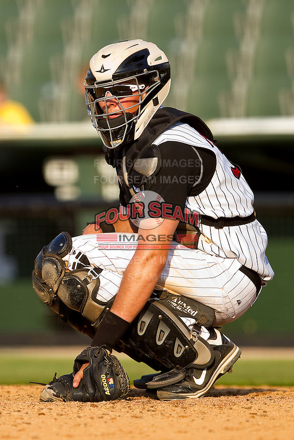 Catcher Mike Blanke #32 of the Kannapolis Intimidators on defense against the Delmarva Shorebirds at Fieldcrest Cannon Stadium on May 22, 2011 in Kannapolis, North Carolina.   Photo by Brian Westerholt / Four Seam Images