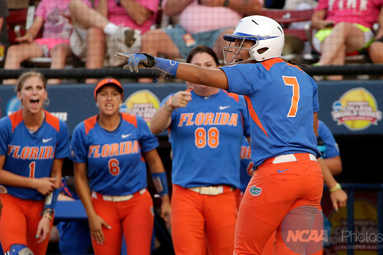 02 JUNE 2014:   Kelsey Stewart (7) of the University of Florida celebrates after scoring against the University of Alabama during the Division I Women's Softball Championship held at ASA Hall of Fame Stadium in Oklahoma City, OK.  Shane Bevel/NCAA Photos