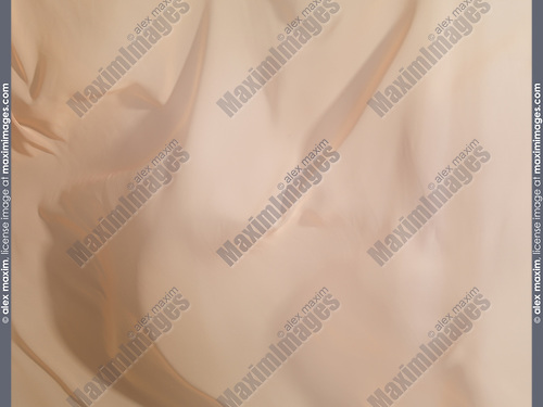 Light beige chiffon fabric in the wind, abstract background texture