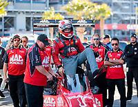Nov 3, 2019; Las Vegas, NV, USA; Crew members surround NHRA top fuel driver Doug Kalitta during the Dodge Nationals at The Strip at Las Vegas Motor Speedway. Mandatory Credit: Mark J. Rebilas-USA TODAY Sports