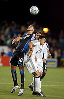 Ramon Sanchez (20) heads the ball over Christian Gomez (right). The San Jose Earthquakes tied DC United 2-2 at Buck Shaw Stadium in Santa Clara, California on July 25, 2009.