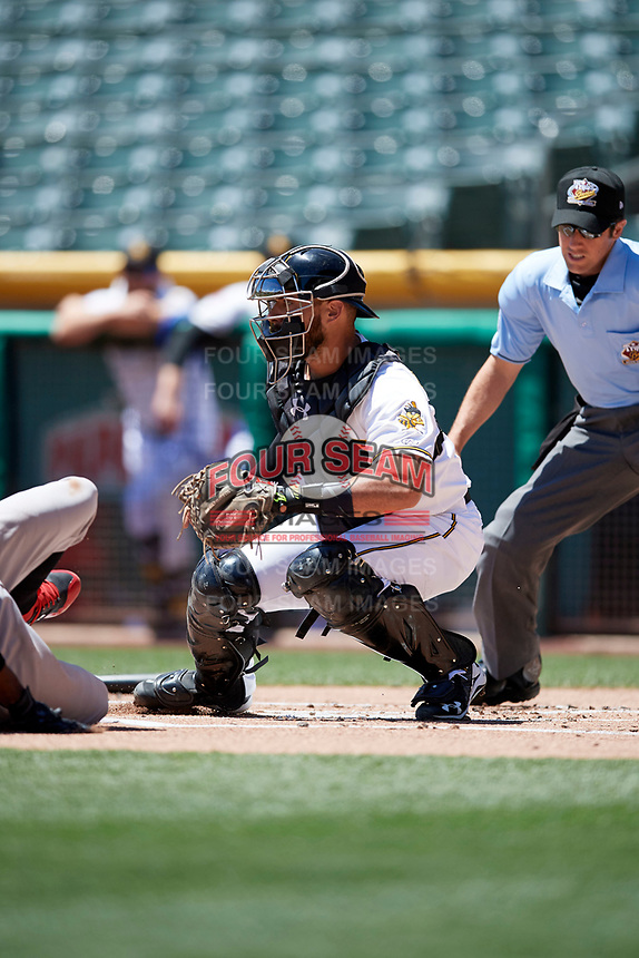 Tony Sanchez (27) of the Salt Lake Bees on defense against the Albuquerque Isotopes in Pacific Coast League action at Smith's Ballpark on June 11, 2017 in Salt Lake City, Utah. The Bees defeated the Isotopes 6-5. (Stephen Smith/Four Seam Images)