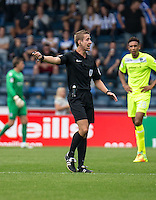 Referee John Brooks during the Sky Bet League 2 match between Wycombe Wanderers and Colchester United at Adams Park, High Wycombe, England on 27 August 2016. Photo by Liam McAvoy.