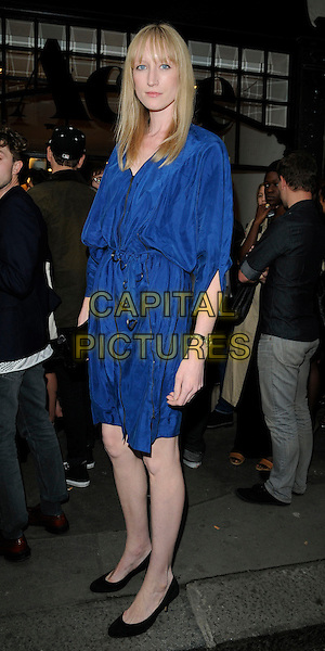 JADE PARFITT .At the opening of the Acne London Studio, Dover Street, London, England, UK, July 15th 2010..full length blue dress waist belt belted black shoes .CAP/CAN.©Can Nguyen/Capital Pictures.