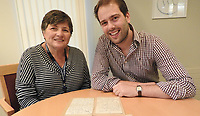 BNPS.co.uk (01202 558833)<br /> Pic: Weldmar/BNPS<br /> <br /> Bev Peck of Weldmar's retail team with Auctioneer Tim Medhurst<br /> <br />  A remarkable letter by Florence Nightingale that sets out her vision for community nursing has been found 122 years later during a house clearance.<br /> <br /> The letter was written by the heroine of nursing in 1897 and was her polite refusal to an invitation to an event she couldn't attend as she was ill. <br /> <br /> In it she talks about training up of nurses to go out into the community and tend to both sick children and the elderly nearing the end of their lives.