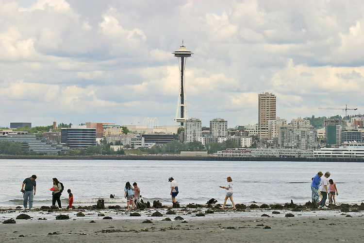 Puget Sound, Seattle, Space Needle, Duwamish Head, West Seattle,Space Needle, people exploring tidelands and turn of the century amusement park Luna Park during the low tide, Washington State, Pacific Northwest, United States,