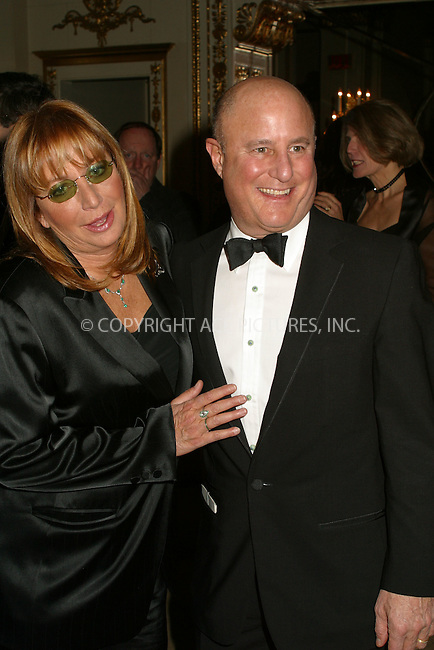 Penny Marshall and Ron Perelman at the Food Allergy Initiative Gala in New York. December 3, 2002. The Food Allergy Initiative supports clinical research to find a cure for life-threatening food allergies, as well as influences public policy to make the wold safer for those afflicted. Please byline: Alecsey Boldeskul/NY Photo Press.   ..*PAY-PER-USE*      ....NY Photo Press:  ..phone (646) 267-6913;   ..e-mail: info@nyphotopress.com