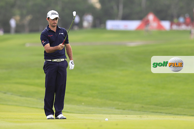 Gary Stal (FRA) prepares to play his 2nd shot on the 13th hole during Sunday's Final Round of the Abu Dhabi HSBC Golf Championship 2015 held at the Abu Dhabi Golf Course, United Arab Emirates. 18th January 2015.<br /> Picture: Eoin Clarke www.golffile.ie