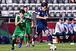 Minamino Takumi of Japan (R) is followed by Hojayev Resul of Turkmenistan (L) during the AFC Asian Cup UAE 2019 Group F match between Japan (JPN) and Turkmenistan (TKM) at Al Nahyan Stadium on 09 January 2019 in Abu Dhabi, United Arab Emirates. Photo by Marcio Rodrigo Machado / Power Sport Images