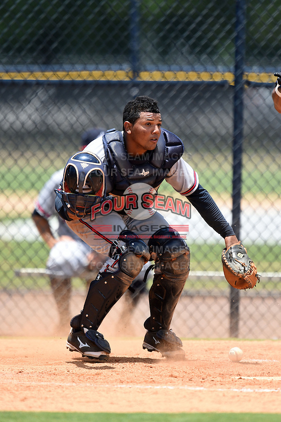 GCL Braves catcher Carlos Martinez (57) checks the runner after blocking a pitch in the dirt during a game against the GCL Yankees 2 on June 23, 2014 at the Yankees Minor League Complex in Tampa, Florida.  GCL Yankees 2 defeated the GCL Braves 12-4.  (Mike Janes/Four Seam Images)