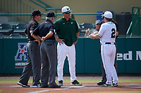 South Florida Bulls head coach Mark Kingston talks with Dartmouth Big Green head coach Bob Whalen (2) during the lineup exchange with umpires Chris Tipton (right, behind Whalen), Mike Schaeffer (left), and Mike Trotter (4) before a game on March 27, 2016 at USF Baseball Stadium in Tampa, Florida.  South Florida defeated Dartmouth 4-0.  (Mike Janes/Four Seam Images)