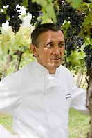 Portrait of Bruno Barbieri the head chef of the two Michelin starred Ristorante Arquade near Verona standing amongst the vines in the vineyards surrounding the restaurant