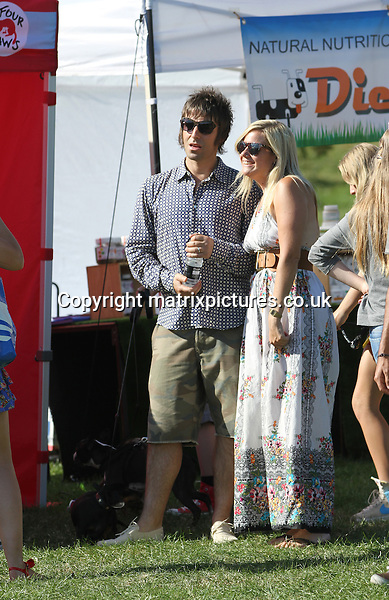EXCLUSIVE ALL ROUND PICTURE: MATRIXPICTURES.CO.UK.PLEASE CREDIT ALL USES..WORLD RIGHTS..Canadian pop singer Nicole Appleton and her English Oasis rocker husband Liam Gallagher are spotted taking their two dachshund's for a walk with their son Gene in Primrose Hill park during the 2012 Pup Aid Fun Dog Show...The pair happily chatted with passers by and stopped to have photos taken with some fans, although Gene seemed a little bored of it all...SEPTEMBER 8th 2012..REF: WTX 123718