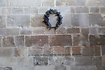 Bronze wreath designed by Sir Edwin Lutyens lettering by Eric Gill, to Raymond Asquith, Mells church, Somerset, England, UK