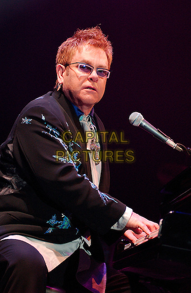"SIR ELTON JOHN.performs as a part of his ""The Captain & The Kid Tour""  held at the Mellon Arena.  Pittsburgh, Pennsylvania, USA,.06 October 2006..concert music gig on stage live half length playing piano funny.Ref: ADM/JN.www.capitalpictures.com.sales@capitalpictures.com.©Jason L Nelson/AdMedia/Capital Pictures."
