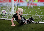 Wayne Rooney of Manchester United youngest child Kit falls in the back of the net during the English Premier League match at the Old Trafford Stadium, Manchester. Picture date: May 21st 2017. Pic credit should read: Simon Bellis/Sportimage