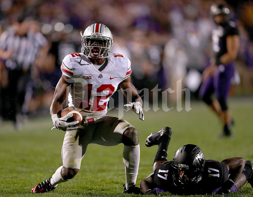 Ohio State Buckeyes cornerback Doran Grant (12) celebrates his interception against Northwestern Wildcats wide receiver Rashad Lawrence (17) during the second half of the NCAA football game between Ohio State and Northwestern at Ryan Field in Evanston, Illinois on Saturday, October 5, 2013. (Columbus Dispatch photo by Jonathan Quilter)