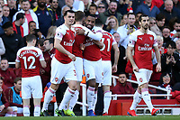Alexandre Lacazette of Arsenal is congratulated after scoring the first goal during Arsenal vs Southampton, Premier League Football at the Emirates Stadium on 24th February 2019