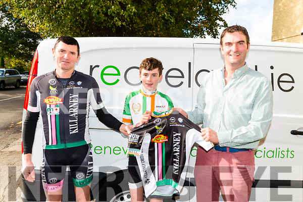 Shane Galvin (centre) was presented with National Jersey in Kerry colours by Stephen Murphy (Renewable Energy Centre) pictured with Mike Kissane at the Open Day for Killarney Youth Cycle Academy in the Beaufort Community Hall last Saturday.