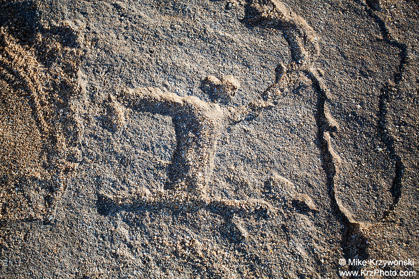 Hawaiian petroglyph  (normally under the sand) near the shoreline at Keiki Beach, North Shore, O'ahu.