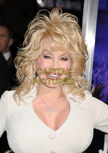 "Dolly Parton.""Joyful Noise"" Los Angeles Premiere held at Grauman's Chinese Theatre, Hollywood, California, USA..January 9th, 2012.headshot portrait white dress sparkly cleavage necklace cross crucifix smiling .CAP/ROT/TM.©Tony Michaels/Roth Stock/Capital Pictures"
