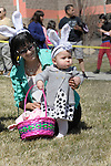 Diana Sears and her daughter Kelly, 9 months, of Carson City, take part in an egg hunt during the 7th Annual Easter Fiesta at Western Nevada College Saturday, March 26, 2016. The event, hosted by the Association of Latin American Students, had 3 separate egg hunts, face painting, limbo, musical chairs, ring toss, sack races, bowling,  food, music and a piñata.  <br />