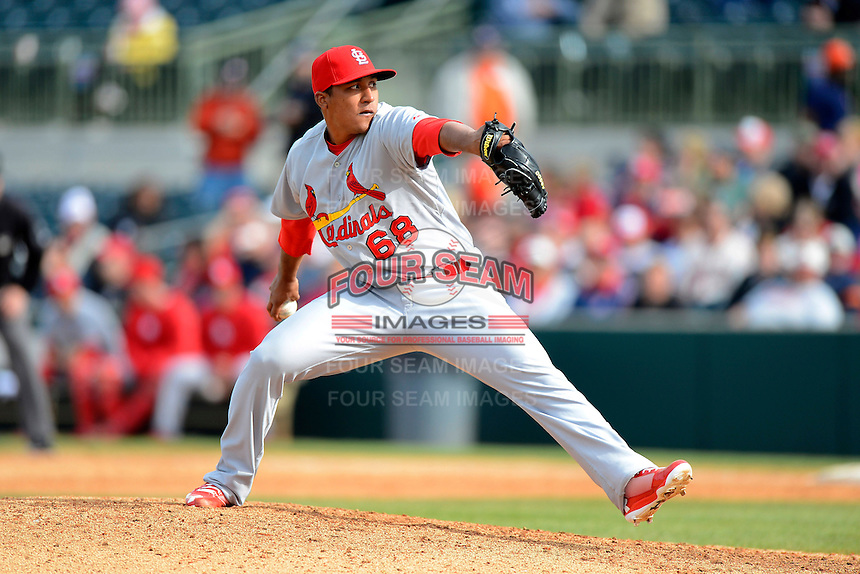 St. Louis Cardinals pitcher Jorge Rondon #68 during a Spring Training game against the Houston Astros at Osceola County Stadium on March 1, 2013 in Kissimmee, Florida.  The game ended in a tie at 8-8.  (Mike Janes/Four Seam Images)