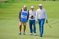 Brandon Grace (RSA) and Jhonattan Vegas (VEN) look over a putt on 14 during round 3 Foursomes of the 2017 President's Cup, Liberty National Golf Club, Jersey City, New Jersey, USA. 9/30/2017.<br /> Picture: Golffile | Ken Murray<br /> <br /> All photo usage must carry mandatory copyright credit (&copy; Golffile | Ken Murray)