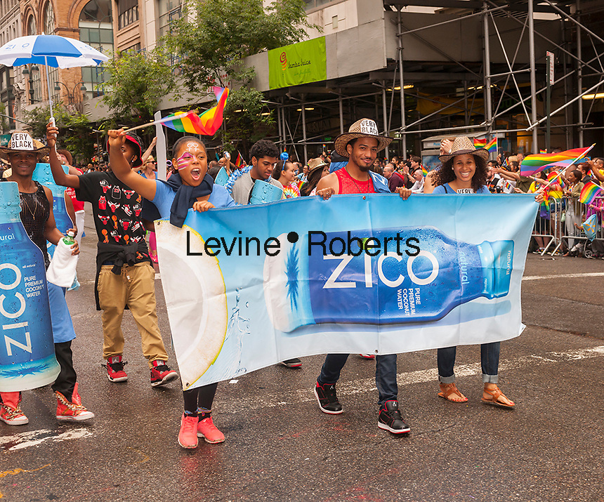 Zico coconut water, a Cocoa-Cola brand,  employees and supporters in the annual Lesbian, Gay, Bisexual and Transgender Pride Parade on Fifth Avenue in New York on Sunday, June 28, 2015. The parade was particularly boisterous due to the recent Supreme Court decision on same-sex marriage. The parade is the largest gay pride parade in the world.(© Richard B. Levine)