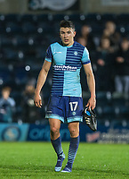 Luke O'Nien of Wycombe Wanderers comes off the pitch holding his boots after the Sky Bet League 2 match between Wycombe Wanderers and Plymouth Argyle at Adams Park, High Wycombe, England on 14 March 2017. Photo by Kevin Prescod / PRiME Media Images.