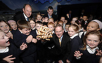 ENDA KENNY IN KERRY 26-4-07 A frightening prospect as Fine Gael Leader Enda Kenny holds up  a spider crab for inspection by young children from St. Josephs School, Dingle during a visit to Dingle Oceanworld on Thursday.<br /> Picture by Don MacMonagle