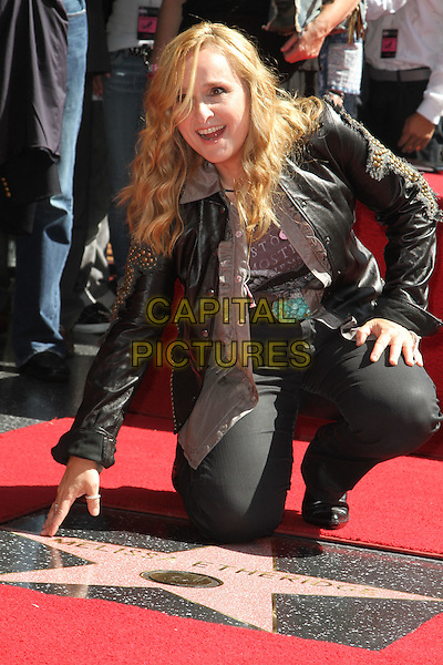Melissa Etheridge.Melissa Etheridge Honored with a star on the Hollywood Walk of Fame  Held at On Hollywood Blvd., Hollywood, California, USA..27 September 2011 .full length black jacket jeans denim leather studs studded hand touching kneeling   .CAP/ADM/KB.©Kevan Brooks/AdMedia/Capital Pictures.