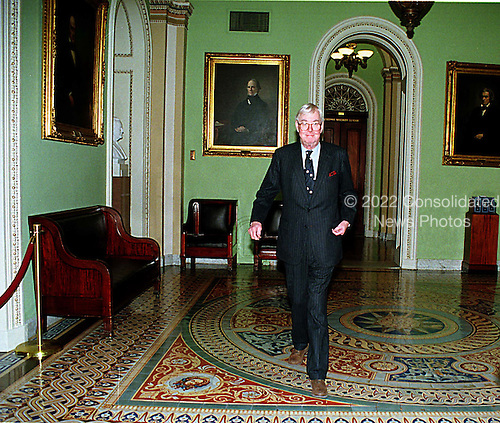 Washington, DC - January 14, 1999 -- United States Senator Daniel Patrick Moynihan (Democrat of New York) walks in the hall outside the Senate Chamber on his way to hear the House Managers present their case against U.S. President Bill Clinton on 14 January, 1999..Credit: Ron Sachs / CNP