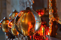 Detail of gilded glass balls and candles surrounding the reliquaries in the Bell tower room themed 'Le Merveilleux' or The Supernatural, first floor, in Le Tresor de la Cathedral d'Angouleme, in Angouleme Cathedral, or the Cathedrale Saint-Pierre d'Angouleme, Angouleme, Charente, France. The 12th century Romanesque cathedral was largely reworked by Paul Abadie in 1852-75. In 2008, Jean-Michel Othoniel was commissioned by DRAC Aquitaine - Limousin - Poitou-Charentes to display the Treasure of the Cathedral in some of its rooms, which opened to the public on 30th September 2016. Picture by Manuel Cohen. L'autorisation de reproduire cette oeuvre doit etre demandee aupres de l'ADAGP/Permission to reproduce this work of art must be obtained from DACS.