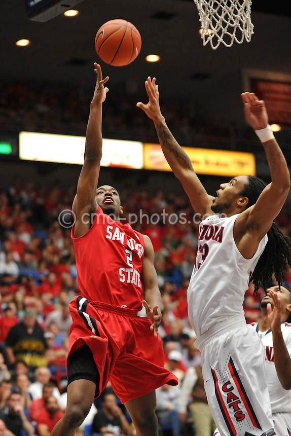 Nov 23, 2011; Tucson, AZ, USA; San Diego State Aztecs guard Xavier Thames (2) shoots over Arizona Wildcats forward Jesse Perry (33) in the second half of a game at the McKale Center.  The Aztecs won 61-57.  Mandatory Credit: Chris Morrison-US PRESSWIRE