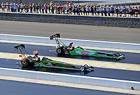 Sept. 18, 2010; Concord, NC, USA; NHRA top fuel dragster drivers Doug Foley (near) races alongside Steve Torrence during qualifying for the O'Reilly Auto Parts NHRA Nationals at zMax Dragway. Mandatory Credit: Mark J. Rebilas /