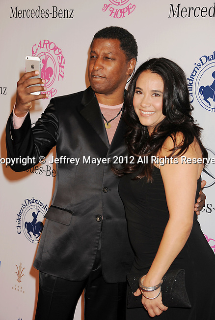 BEVERLY HILLS, CA - OCTOBER 20: Kenny Babyface Edmonds and Nicole Pantenburg arrive at the 26th Anniversary Carousel Of Hope Ball presented by Mercedes-Benz at The Beverly Hilton Hotel on October 20, 2012 in Beverly Hills, California.