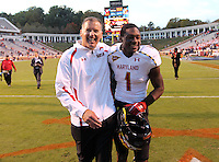 Maryland Terrapins head coach Randy Edsall walks off the field with Maryland Terrapins wide receiver Stefon Diggs (1) during the game against Virginia in Charlottesville, Va. Maryland defeated Virginia 27-20.