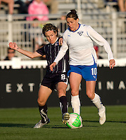 Sonia Bompastor (8) of the Washington Freedom tackles the ball away from Kelly Smith (10) of the Boston Breakers at the Maryland SoccerPlex in Boyds, Maryland. The Washington Freedom tied the Boston Breakers, 0-0.