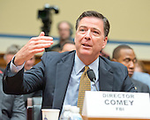 FBI Director James Comey testifies before the United States House Committee on Oversight and Government Reform following his announcement on Tuesday that he would recommend not to prosecute former US Secretary of State Hillary Clinton for maintaining a private server on Capitol Hill in Washington, DC on Thursday, July 7, 2016.<br /> Credit: Ron Sachs / CNP<br /> (RESTRICTION: NO New York or New Jersey Newspapers or newspapers within a 75 mile radius of New York City)