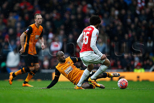 20.02.2016. The Emirates, London, England. Emirates FA Cup 5th Round. Arsenal versus Hull City. Sone Aluko of Hull slide tackles Mohamed Elneny of Arsenal.  The game finished in a tight 0-0 draw